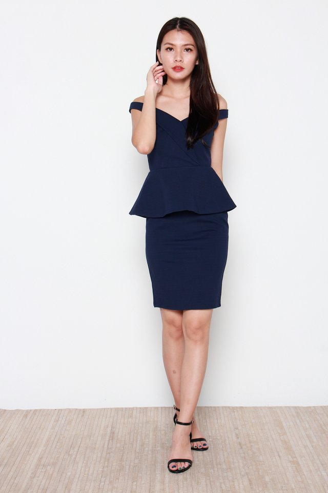 Claudie Off Shoulder Peplum Dress in Navy Blue